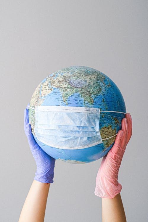 Coronavirus mask on globe